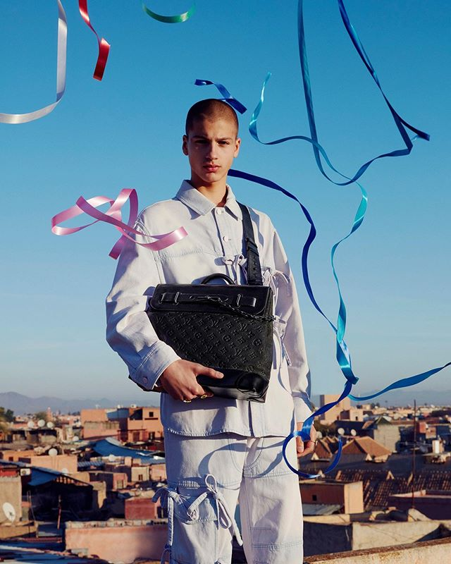 Lucien (@lucien.bzh) for Louis Vuitton's Men's New Classics Spring/Summer 2020 campaign. Photography by Viviane Sassen, styling by Ben Perreira, hair by Karim Belghiran, makeup by Satoko Watanabe and casting by Samuel Ellis Scheinman.